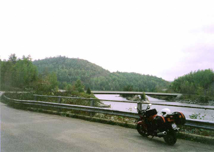 Bike parked beside river